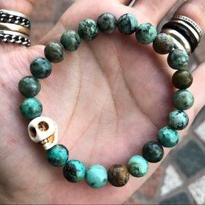 Genuine african turquoise skull bead bracelet